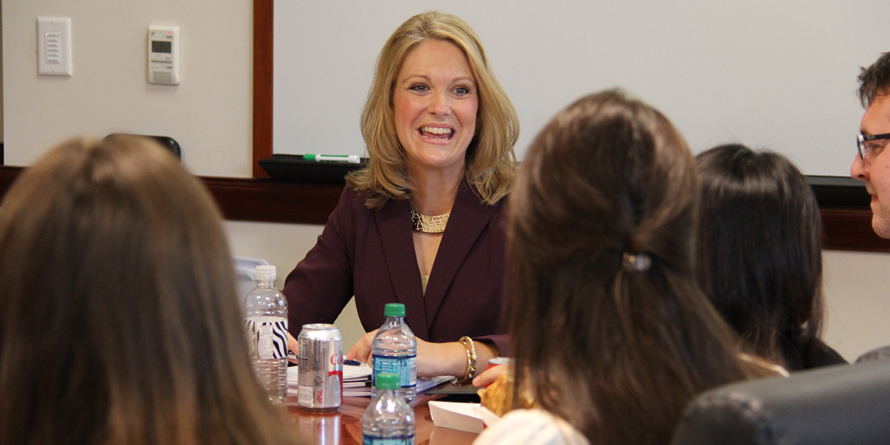 alumna meets with students