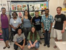 Participants after speaking with Farmworker Association staff members Luckner Millien and Pascale Vincent in front of the Farmworker Memorial Quilt (Left to Right: 2L Daynica Harley, 1L Lauren Rolfe, 3L Margeling Santiago, 1L Peyton Smith, 1L Yazel Sepulveda, 1L Barclay Mitchell).