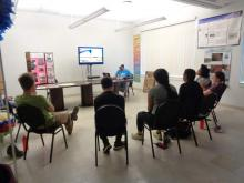Participants listening to a presentation by Farmworkers Association staff member Jose Antonio.