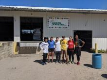 Participants outside of the Green Masters Nursery after working alongside nursery workers (Left to Right: 1L Lauren Rolfe, 1L Peyton Smith, 1L Yazel Sepulveda, 1L Barclay Mitchell, 3L Margeling Santiago, 2L Daynica Harley).